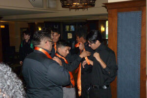 Elevate Phoenix youth charity students trying to tie their ties