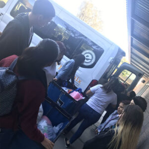Elevate Phoenix youth charity students boarding buses